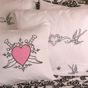 Swallow and Heart and Dagger Throw Pillows